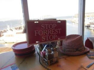 """Stop Forrest Stop"" signpost to call for a waiter."