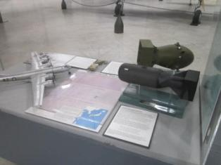 """B-29 """"Enola Gay"""" replica and """"Little Boy"""" bomb replica (at Pima Air and Space Museum)."""