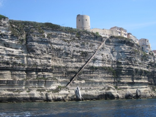"""Stairway of the King of Aragon"", legendarily carved out of the steep cliff face before Bonifacio in a single night during Alfonso V's siege of the town."