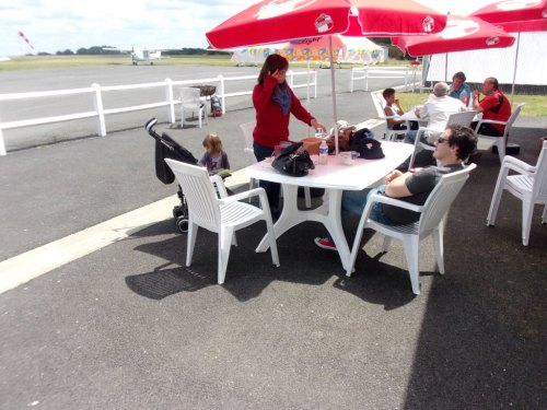 "The fellows from the ""Aeroclub du Sarladais"" got out those table, parasols and chairs for us to have lunch with them."